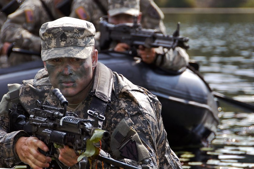 u-s-army-staff-sgt-james-gibson-scans-the-terrain-while-his-battle-buddies-keep-a-watchful-eye-from-the-water