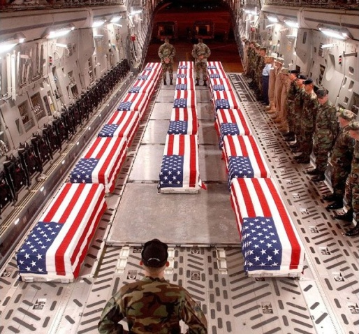 american-flag-over-coffins-in-plane